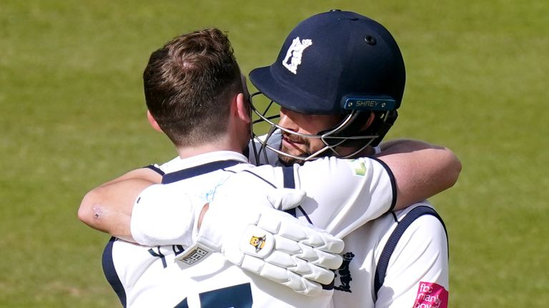 Warwickshire's Rob Yates (left) celebrates his century with team-mate Will Rhodes during day two of the Bob Willis Trophy Final at Lord's