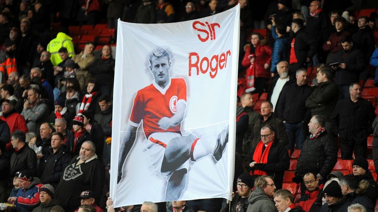 Liverpool supporters hold a banner paying tribute to former player Roger Hunt.