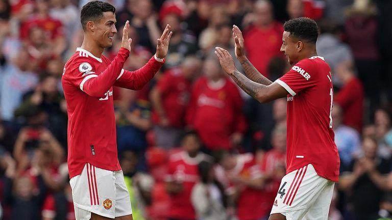 Lingard celebrates with Ronaldo after scoring against Newcastle