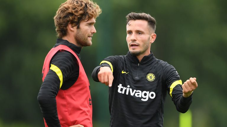 Saul Niguez speaks to Marcos Alonso in Chelsea training