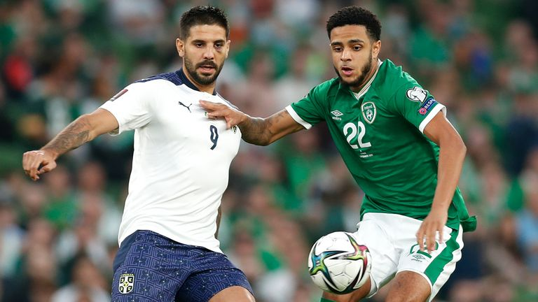 Serbia's Aleksandar Mitrovic battles for possession with Republic of Ireland's with Andrew Omobamidele