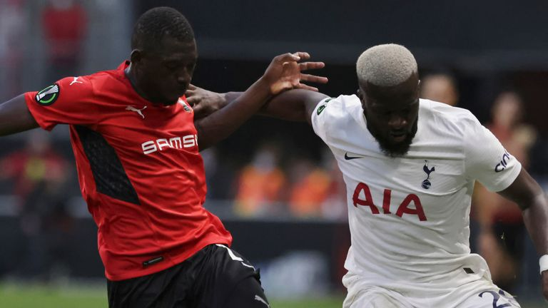 Rennes' Hamari Traore, left, challenges the ball to Tottenham's Tanguy Ndombele