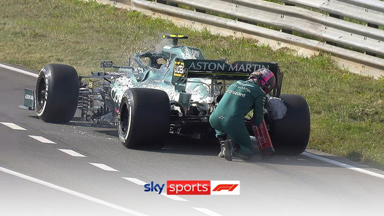 With smoke billowing out of his car, Vettel hops out of the car, finds a fire extinguisher and gets to work!