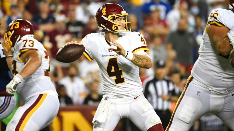 Washington Football Team quarterback Taylor Heinicke (4) looks to pass the ball during the fourth quarter of an NFL football game against the New York Giants, Thursday, Sept. 16, 2021, in Landover, Md. (AP Photo/Terrance Williams)