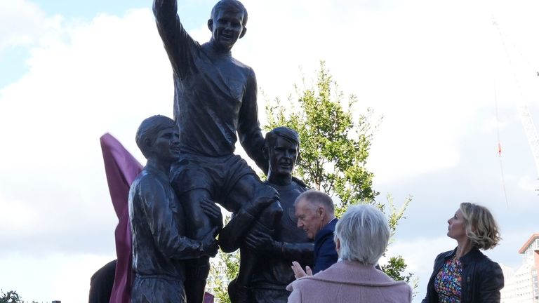 Sir Geoff Hurst, with Roberta Moore and Kathy Peters unveil the new statue of the three West Ham legendary World Cup and European Champions Cup winning players Sir Geoff, Bobby Moore and Martin Peters at the London Stadium