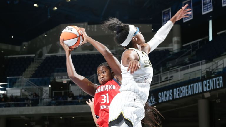 Tina Charles #31 of the Washington Mystics rebounds the ball during the game against the Chicago Sky on September 12, 2021 at the Wintrust Arena in Chicago, Illinois.