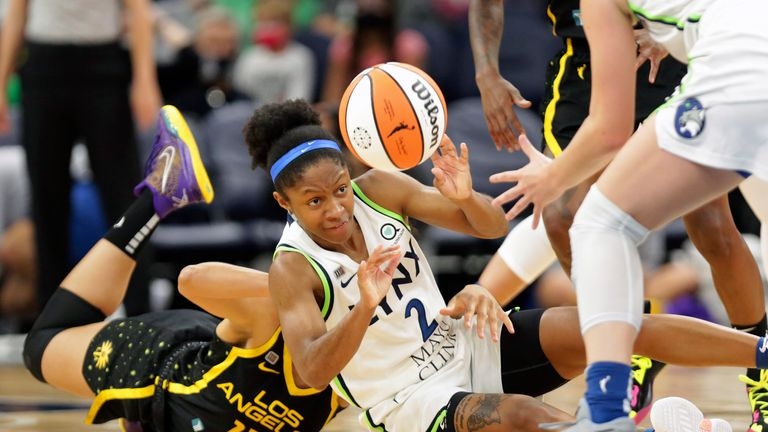 Minnesota Lynx Guard Crystal Dangerfield (2) passes after getting the ball from Los Angeles Sparks forward nia coffee (12) in the fourth quarter of    a WNBA basketball game, Thursday 2 Sept.  2021 in Minneapolis.  (AP Photo/Andy Clayton-King)