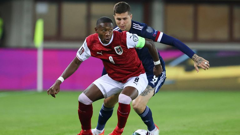 Austria's David Alaba (L) and Scotland's Lyndon Dykes during the FIFA World cup Qualifier between Austria and Scotland at the Ernst-Happel-Stadion