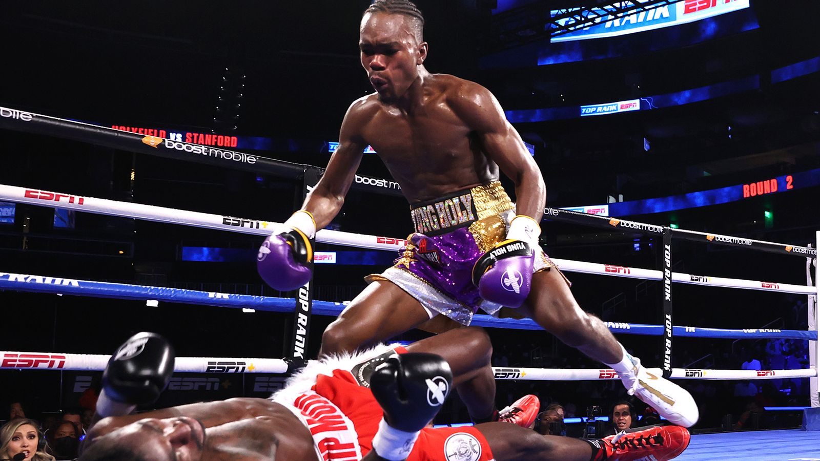 Evander Holyfield's son Evan delivers a massive second-round stoppage to extend unbeaten record