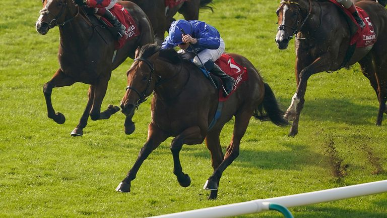 NEWMARKET, ENGLAND - OCTOBER 09: William Buick riding Coroebus (blue) win The Emirates Autumn Stakes at Newmarket Racecourse on October 09, 2021 in Newmarket, England. (Photo by Alan Crowhurst/Getty Images)