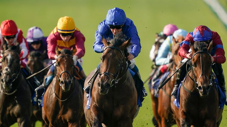 NEWMARKET, ENGLAND - OCTOBER 09: William Buick riding Native Trail (C, blue) win The Darley Dewhurst Stakes at Newmarket Racecourse on October 09, 2021 in Newmarket, England. (Photo by Alan Crowhurst/Getty Images)