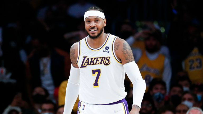 Los Angeles Lakers forward Carmelo Anthony (7) smiles during the second half of an NBA basketball game against the Memphis Grizzlies in Los Angeles, Sunday, Oct. 24, 2021. The Lakers won 121-118.