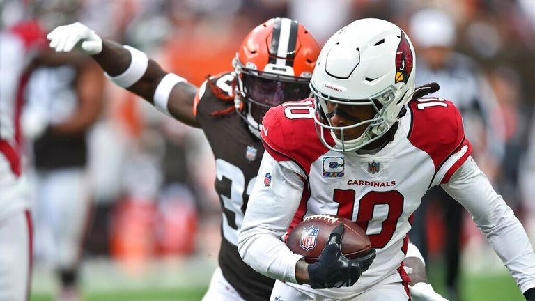 Arizona Cardinals wide receiver DeAndre Hopkins (10) scores a 13-yard touchdown as Cleveland Browns defensive back Ronnie Harrison cannot make a tackle during the first half of an NFL football game Sunday, Oct. 17, 2021, in Cleveland. (AP Photo/David Richard)