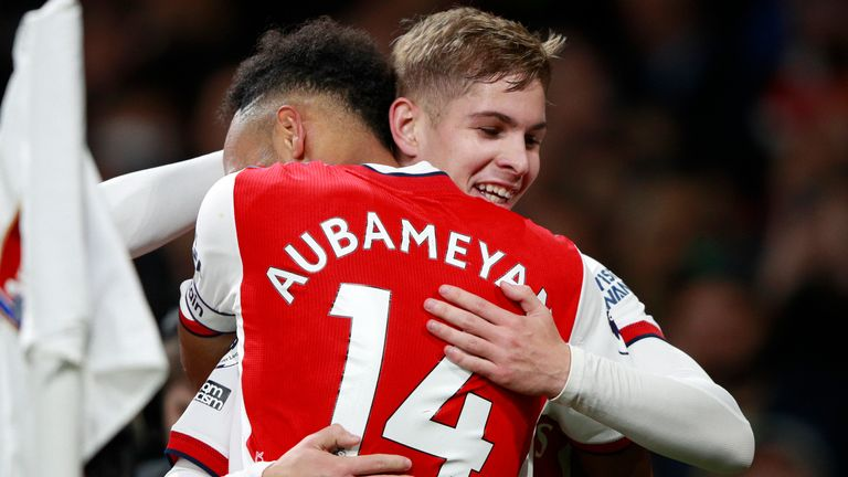 Arsenal's Emile Smith Rowe, right, celebrates with Arsenal's Pierre-Emerick Aubameyang after scoring his side's third goal during the Premier League match between Arsenal and Aston Villa at the Emirates