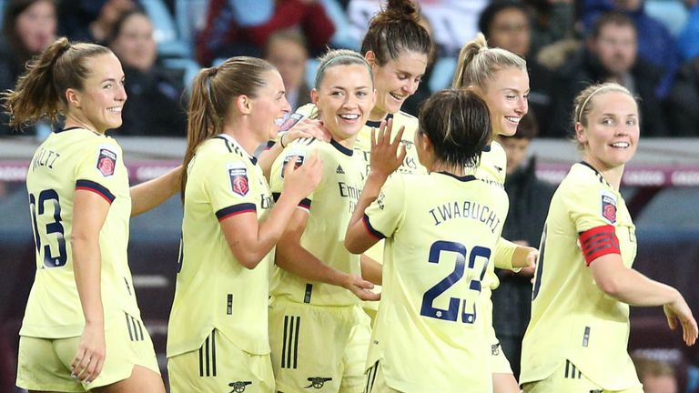 Arsenal's Katie McCabe (third left) is congratulated by her teammates after scoring her side's third goal of the game during the FA Women's Super League match at Villa Park