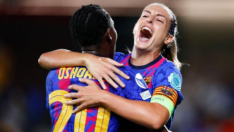 Alexia Putellas celebrates with Asisat Oshoala after scoring Barcelona's second goal against Arsenal