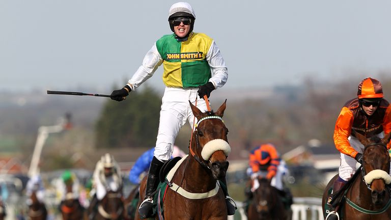 Ballabriggs, ridden by Jason Maguire, wins the Grand National in 2011