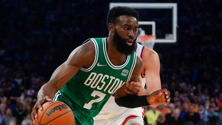 Boston Celtics' Jaylen Brown (7) drives past New York Knicks' Evan Fournier during the second half of an NBA basketball game Wednesday, Oct. 20, 2021, in New York. The Knicks won 138-134. (AP Photo/Frank Franklin II)