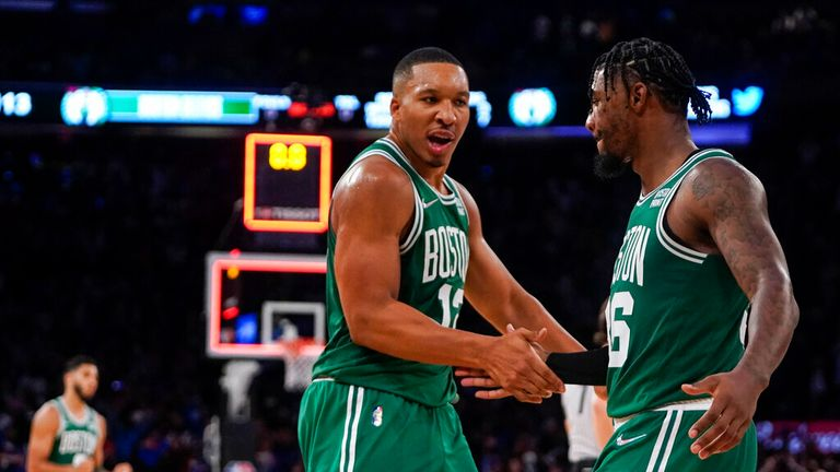 Boston Celtics' Grant Williams (12) celebrates with Marcus Smart (36) after Smart made a three point basket to force overtime during the second half of an NBA basketball game against the New York Knicks Wednesday, Oct. 20, 2021, in New York. The Knicks won 138-134. (AP Photo/Frank Franklin II)