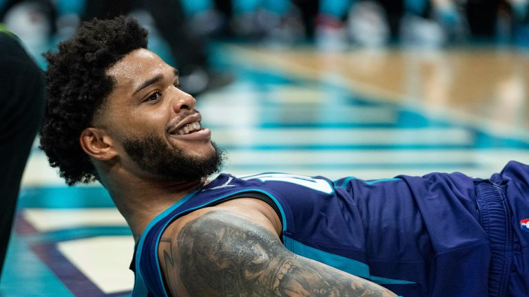 Charlotte Hornets forward Miles Bridges (0) reacts after making a shot while being fouled during an NBA basketball game against the Boston Celtics in Charlotte, N.C., Monday, Oct. 25, 2021.