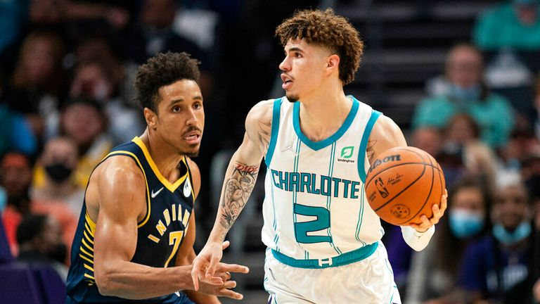 Charlotte Hornets guard LaMelo Ball (2) is guarded by Indiana Pacers guard Malcolm Brogdon (7) during an NBA basketball game in Charlotte, N.C., Wednesday, Oct. 20, 2021. (AP Photo/Jacob Kupferman)