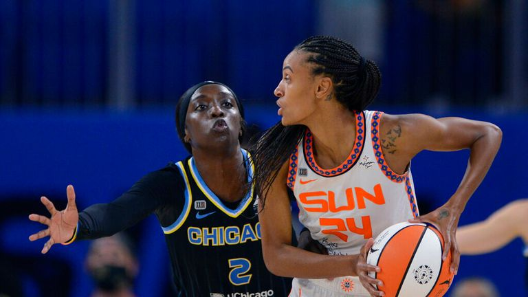 Chicago Sky's Kahleah Copper (2) guards Connecticut Sun's DeWanna Bonner (24) during the second half of Game 3 of a WNBA semifinal playoff basketball game Sunday, Oct. 3, 2021, in Chicago. Chicago won 86-83. (AP Photo/Paul Beaty)