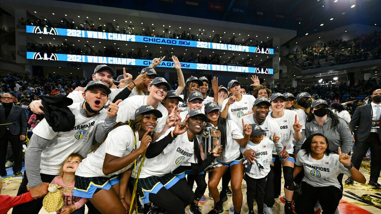Members of the Chicago Sky pose for a photo after defeating the Phoenix Mercury in Game 4 of the WNBA Finals, Sunday, Oct. 17, 2021, in Chicago. (AP Photo/Paul Beaty)