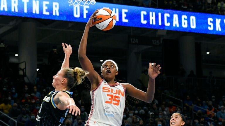 s Jonquel Jones (35) goes up for a shot against 's Courtney Vandersloot (22) and Candice Parker right, during the second half of Game 4 of a WNBA basketball playoff semifinal, Wednesday, Oct. 6, 2021, in Chicago. Chicago won 79-69. (AP Photo/Paul Beaty)