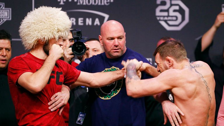 Conor McGregor, right, knocks away Khabib Nurmagomedov's hand during a faceoff at a ceremonial weigh-in for a UFC 229 mixed martial arts bout Friday, Oct. 5, 2018, in Las Vegas. (AP Photo/John Locher)