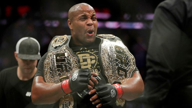 Daniel Cormier reacts after defeating Derrick Lewis by submission in the second round of a heavyweight mixed martial arts bout at UFC 230, early Sunday, Nov. 4, 2018, at Madison Square Garden in New York. (AP Photo/Julio Cortez)