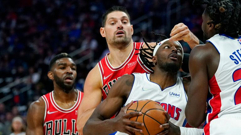 Detroit Pistons forward Jerami Grant (9) drives as Chicago Bulls center Nikola Vucevic defends during the first half of an NBA basketball game, Wednesday, Oct. 20, 2021, in Detroit. (AP Photo/Carlos Osorio)