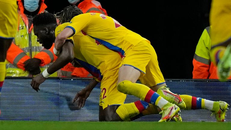 Crystal Palace's Odsonne Edouard, centre left, celebrates with team mates after scoring his side's second goal during an English Premier League soccer match between Arsenal and Crystal Palace at the Emirates Stadium in London, England, Monday Oct. 18, 2021. (AP Photo/Alastair Grant)
