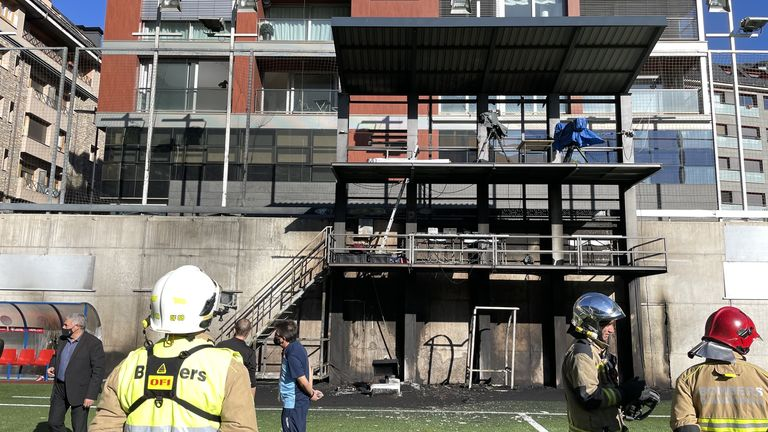 Emergency Services inspect damage at the Andorra National Stadium after a fire broke out in the broadcast gantry