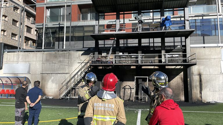 Emergency Services inspect damages after a fire broke out at the Andorra National Stadium in the broadcast gantry