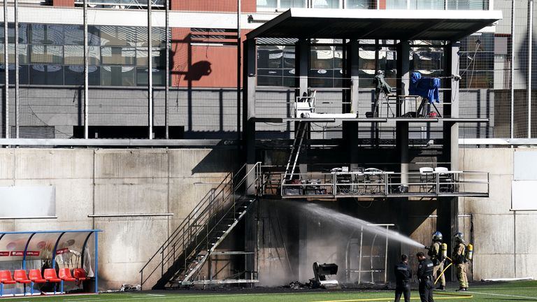 Emergency services fight a fire at Andorra's national stadium a day before they play England in a World Cup qualifier