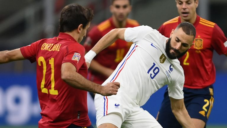 Karim Benzema battles for possession with Mikel Oyarzabal
