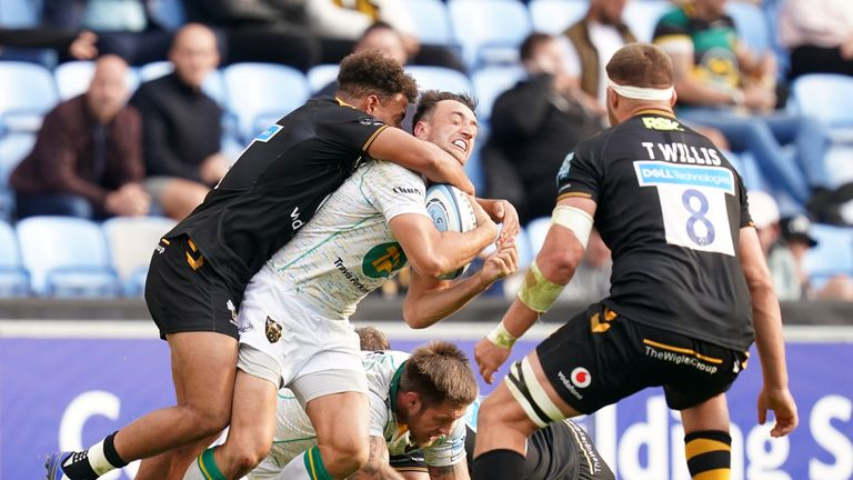 Wasps' Gabriel Oghre tackles Northampton Saints' Alex Mitchell resulting in a yellow card