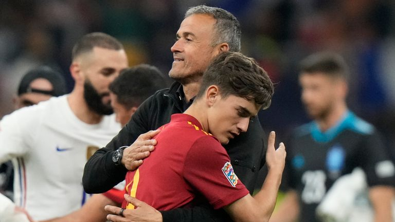 Gavi is embraced by Luis Enrique as he departs