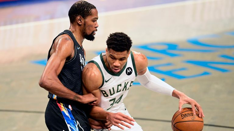 Giannis Antetokounmpo of the Milwaukee Bucks is defended by Kevin Durant of the Brooklyn Nets during the Eastern Conference Finals last season