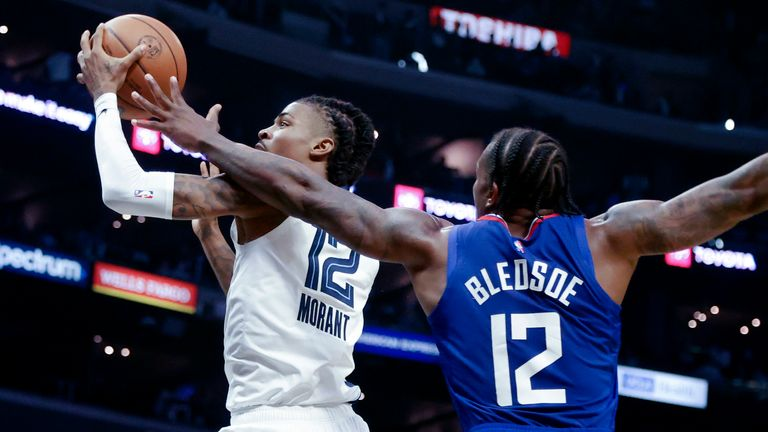 Memphis Grizzlies guard Ja Morant goes to the basket as Los Angeles Clippers guard Eric Bledsoe defends