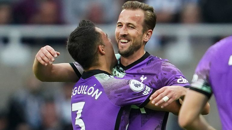 Tottenham's Harry Kane, centre, celebrates with Sergio Reguilon after scoring his side's second goal during an English Premier League soccer match between Newcastle and Tottenham Hotspur at St. James' Park in Newcastle, England, Sunday Oct. 17, 2021. (AP Photo/Jon Super)
