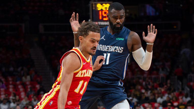 Atlanta Hawks guard Trae Young drives by Dallas Mavericks' Tim Hardaway Jr.
