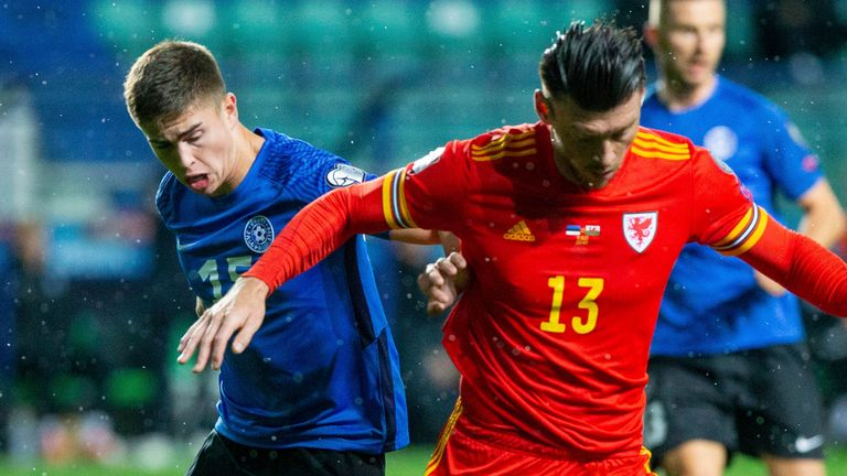 Moore fights for the ball with Estonia's Maksim Paskotsi