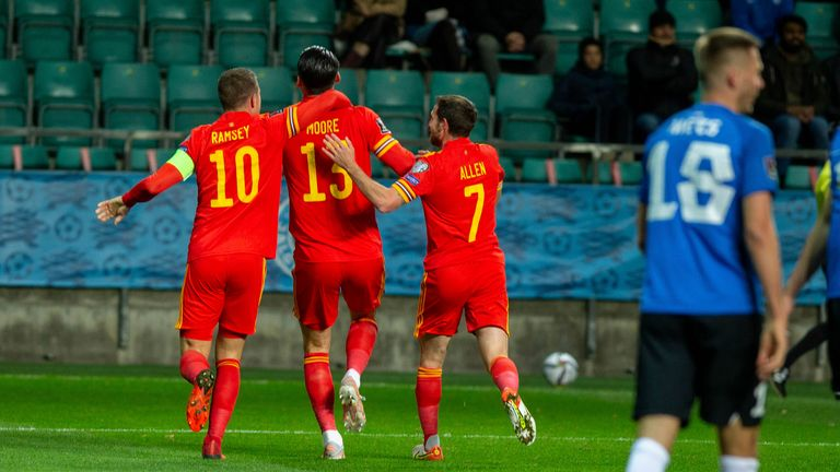 Wales' players celebrates after Moore's stike