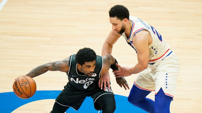 Brooklyn Nets' Kyrie Irving tries to get past Philadelphia 76ers' Ben Simmons