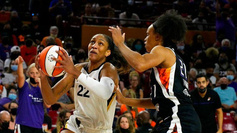 Las Vegas Aces forward A'ja Wilson (22) drives against Phoenix Mercury forward Brianna Turner during the second half of a WNBA basketball game, Sunday, Oct. 3, 2021, in Phoenix. (AP Photo/Rick Scuteri)