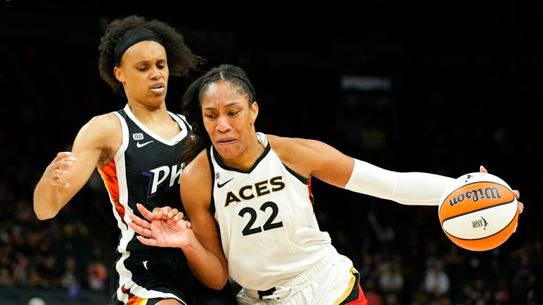 forward A'ja Wilson (22) drives on forward Brianna Turner during the second half of Game 4 of a WNBA basketball playoff series Wednesday, Oct. 6, 2021, in Phoenix. Las Vegas won 93-76. (AP Photo/Rick Scuteri)