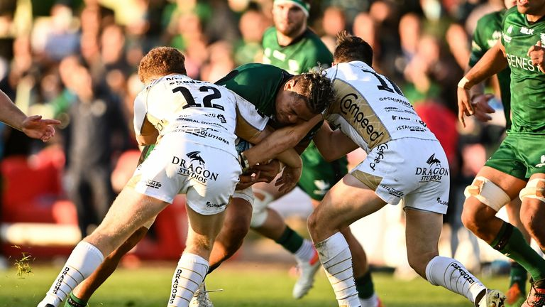 Connacht's Leva Fifita in action against Aneurin Owen, left, and Sam Davies of Dragons