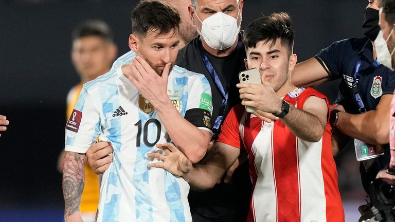 Messi was mobbed by a pitch-invader at the final whistle