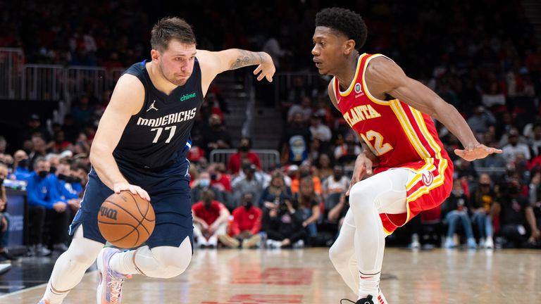 Dallas Mavericks' Luka Doncic drives past Atlanta Hawks' Cam Reddish